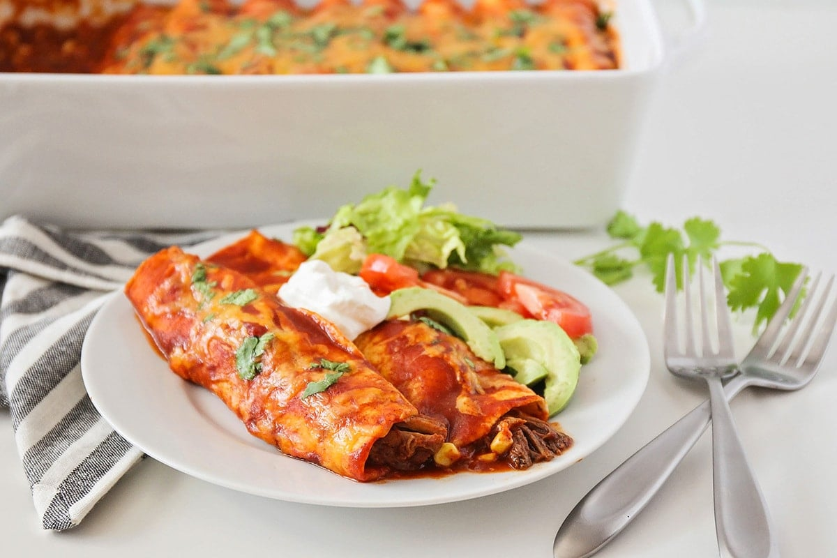 Mexican Christmas dinner - Beef enchiladas on a white plate