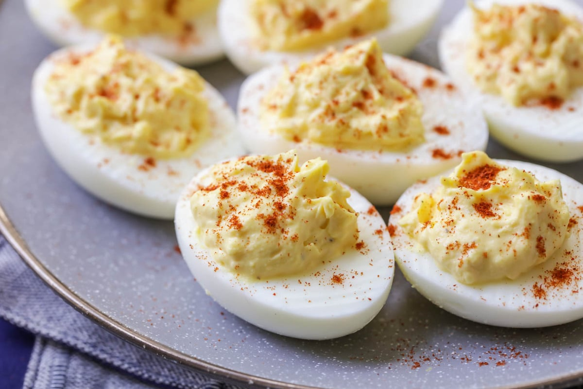 Deviled eggs on a platter as a make ahead Christmas appetizer