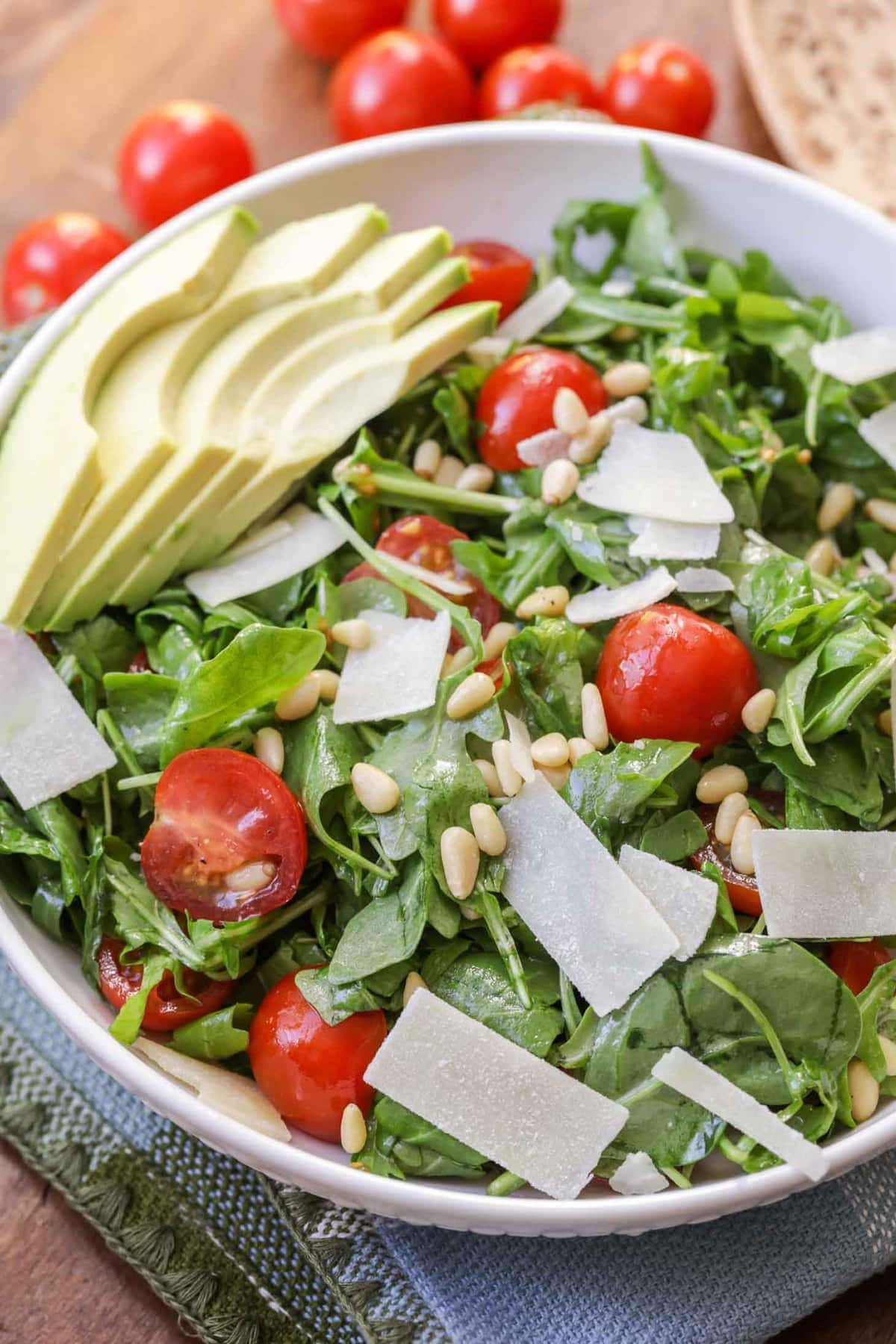 Simple Arugula Salad in a white bowl