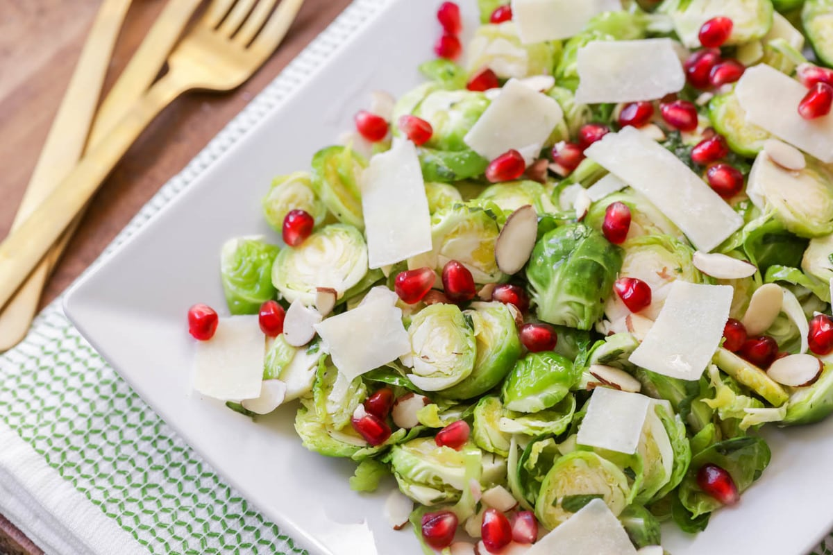 Brussel Sprout Salad with pomegranate on plate