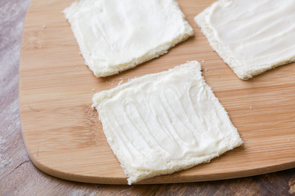 Bread slices spread with cream cheese