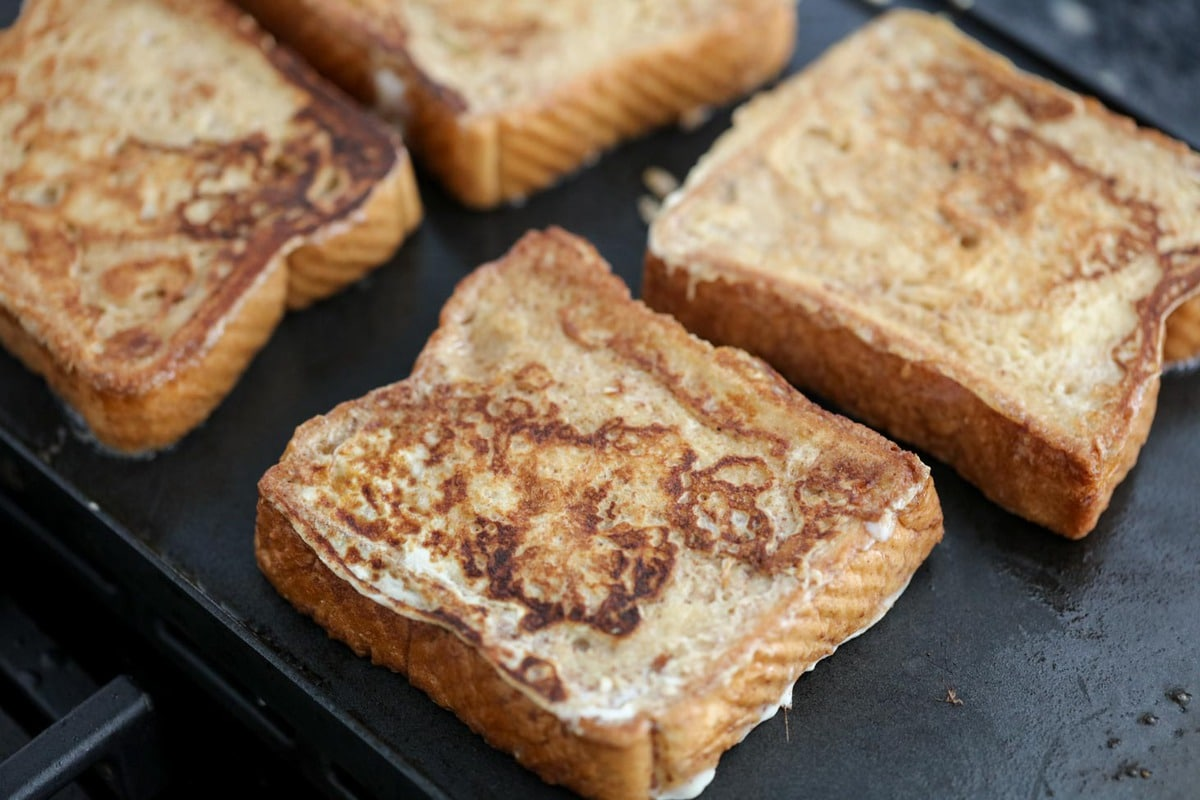 Best French Toast Recipe cooking on skillet