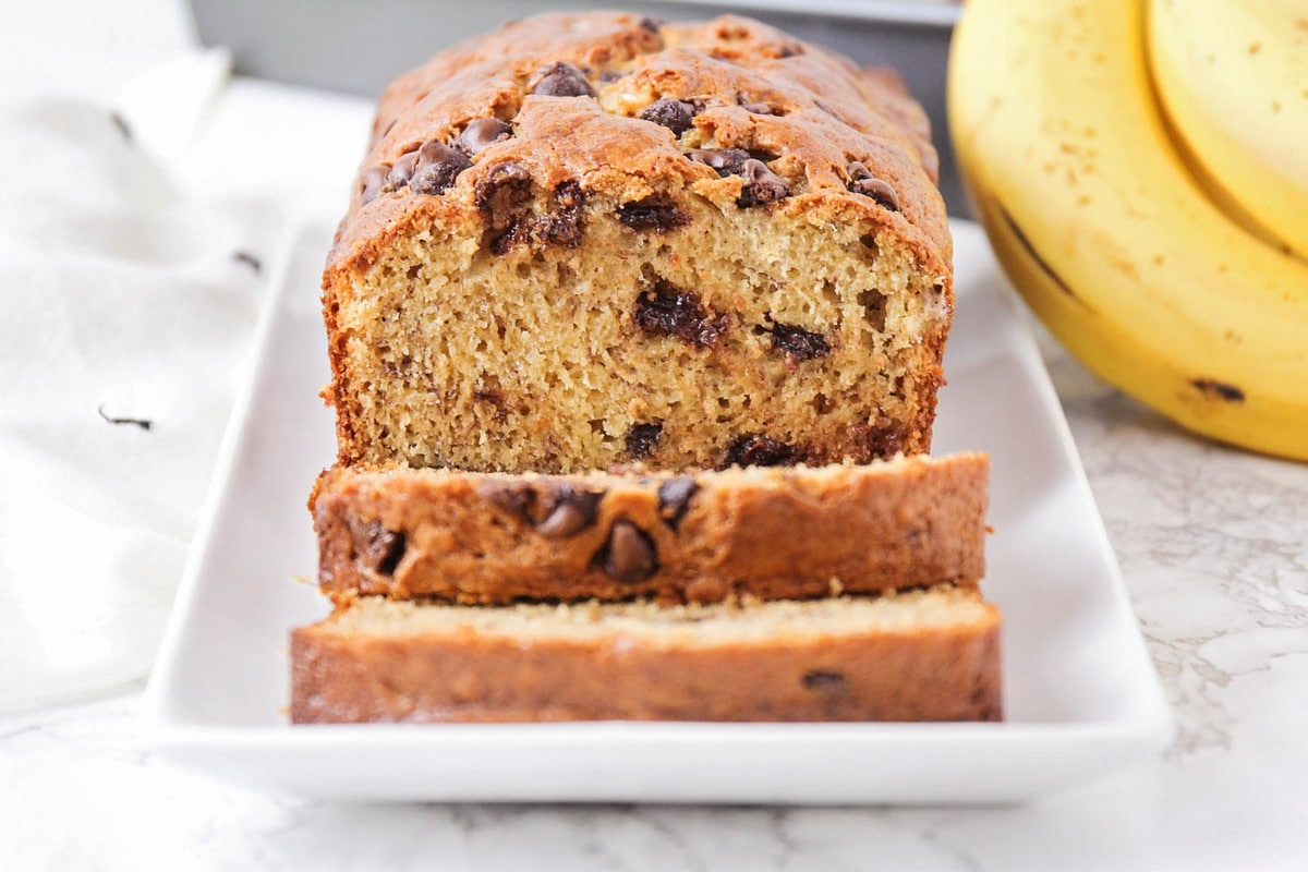 Chocolate chip banana bread on a serving platter
