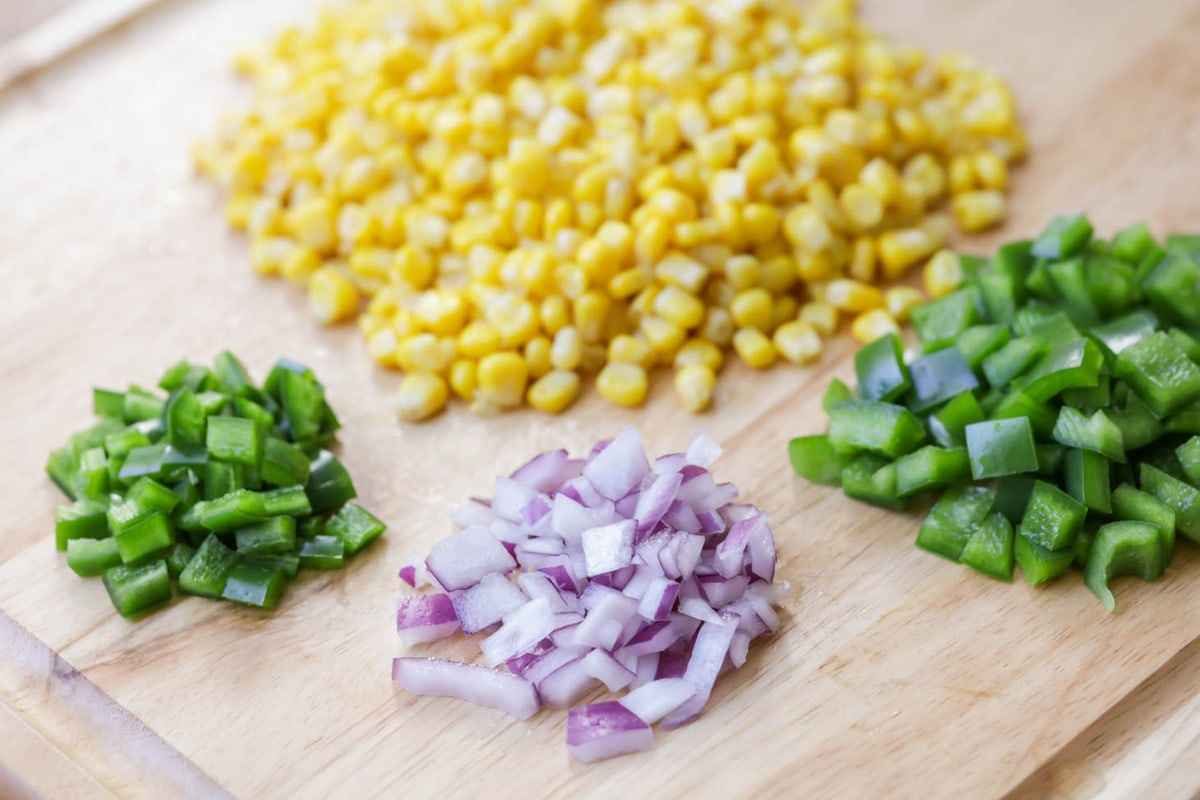 How to make corn salsa - ingredients on cutting board