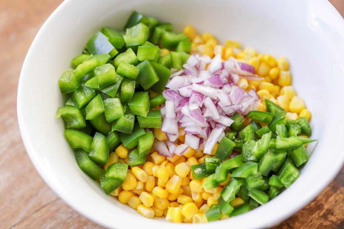 Corn salsa dip ingredients in bowl