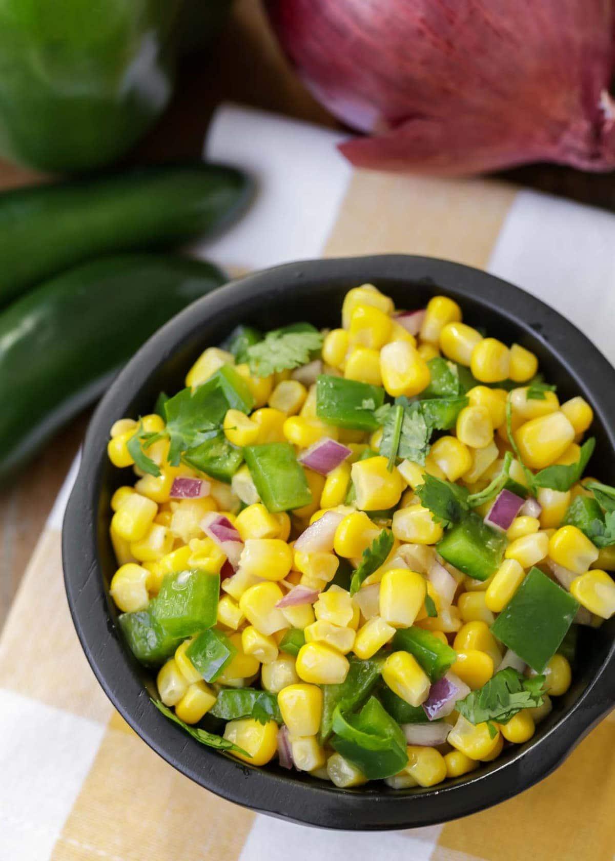 Fresh corn salsa in black bowl