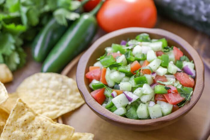Cucumber salsa in a small bowl - one of our favorite cold dips