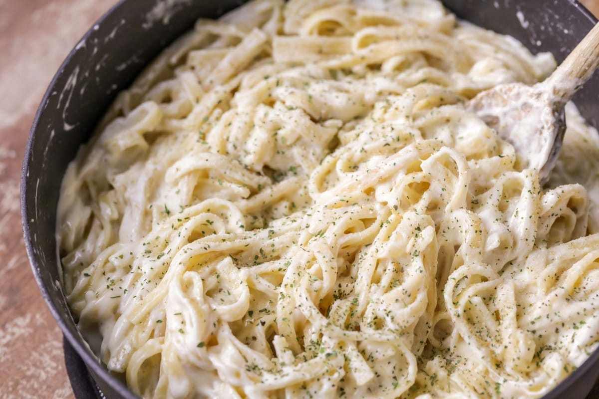 Fettuccine Alfredo mixed in pan