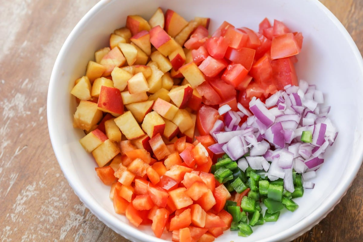 Peach salsa recipe ingredients in bowl