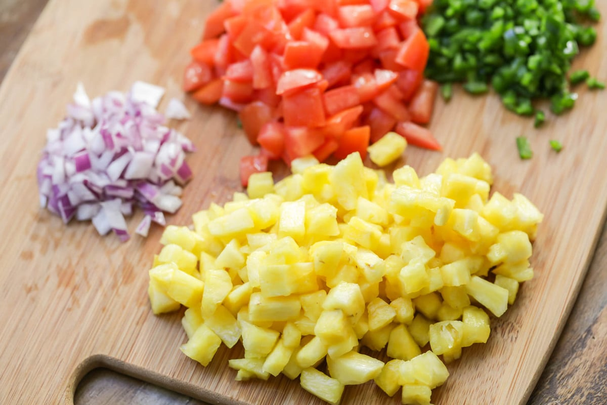 Pineapple salsa recipe ingredients on cutting board