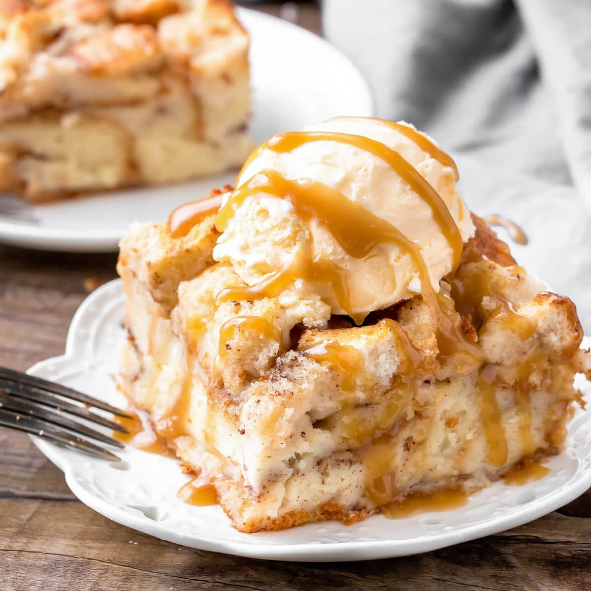 Bread pudding with caramel sauce on plate