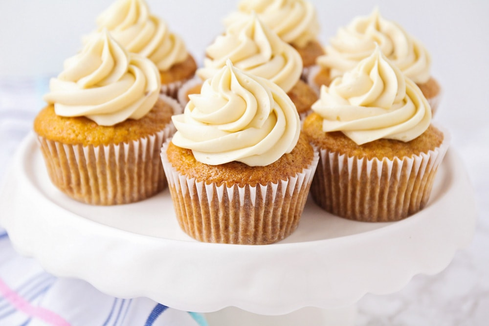 Carrot cake cupcakes on white cake stand