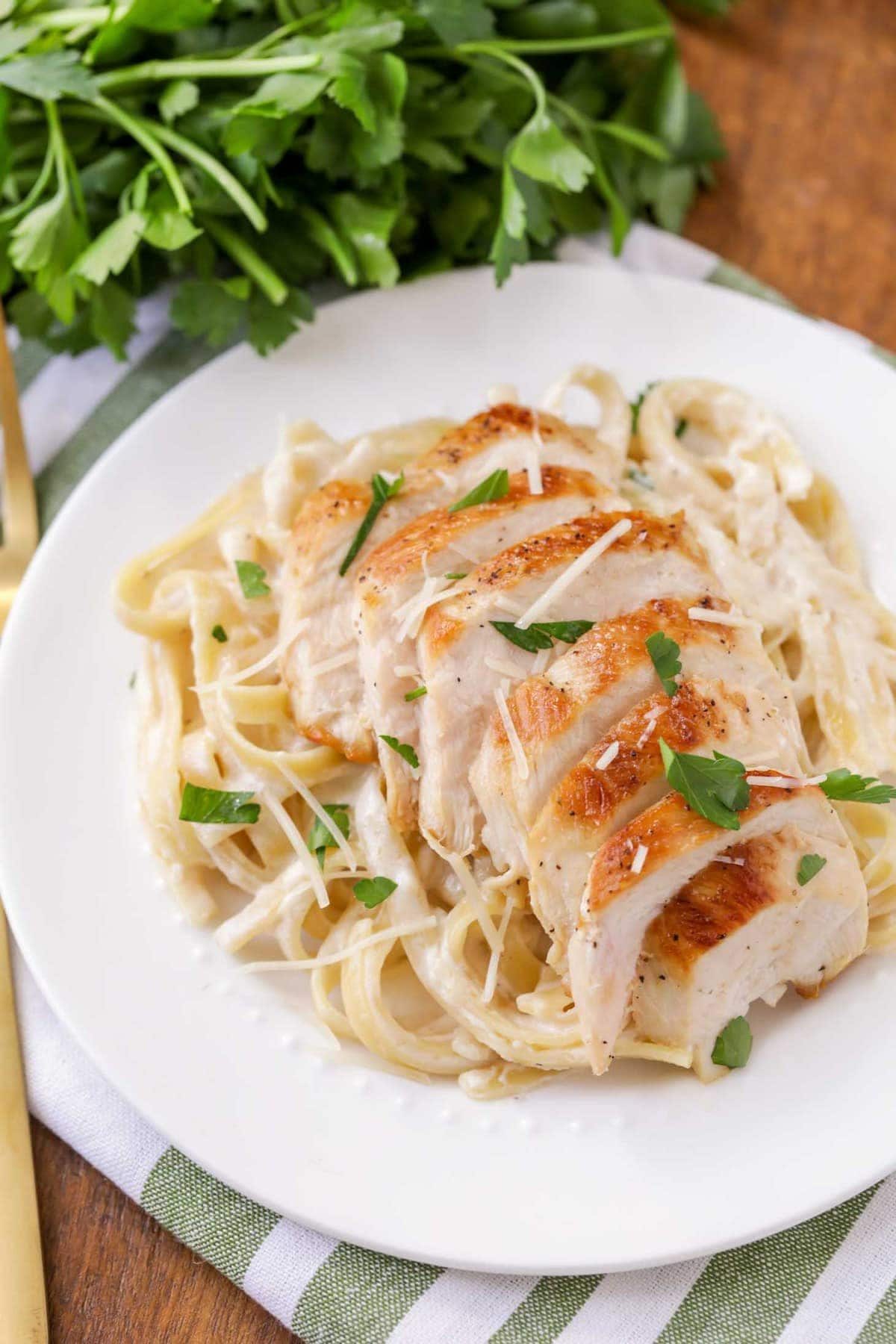 Chicken Fettuccine Alfredo served with fresh parsley
