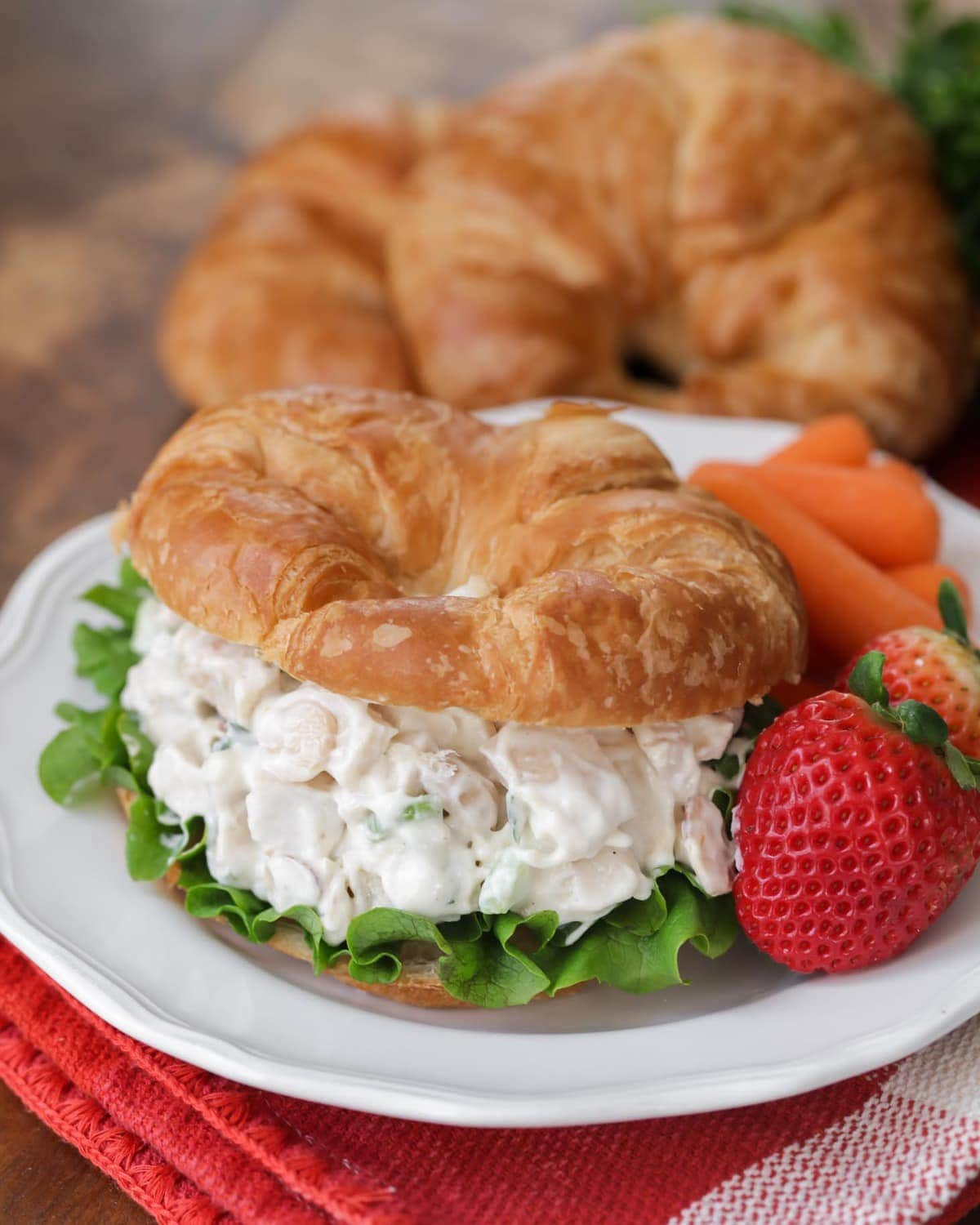 Chicken salad sandwich recipe with strawberries on the side