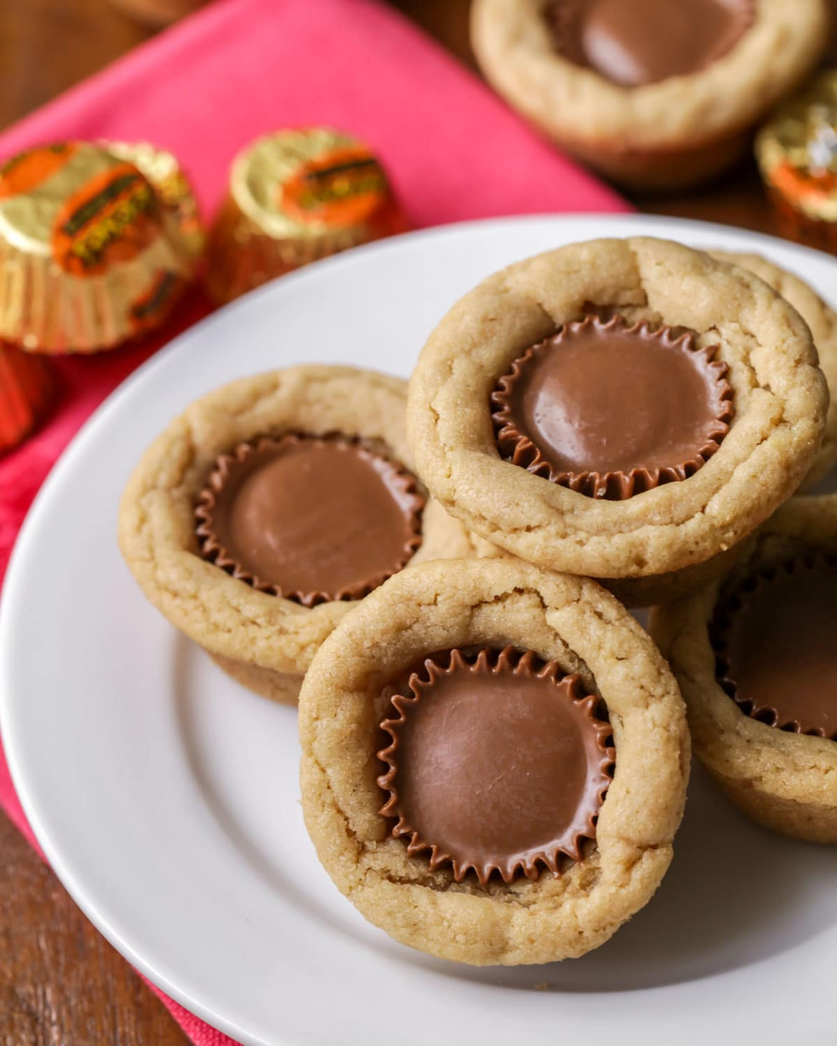 Reese's cup cookies stacked on a white plate