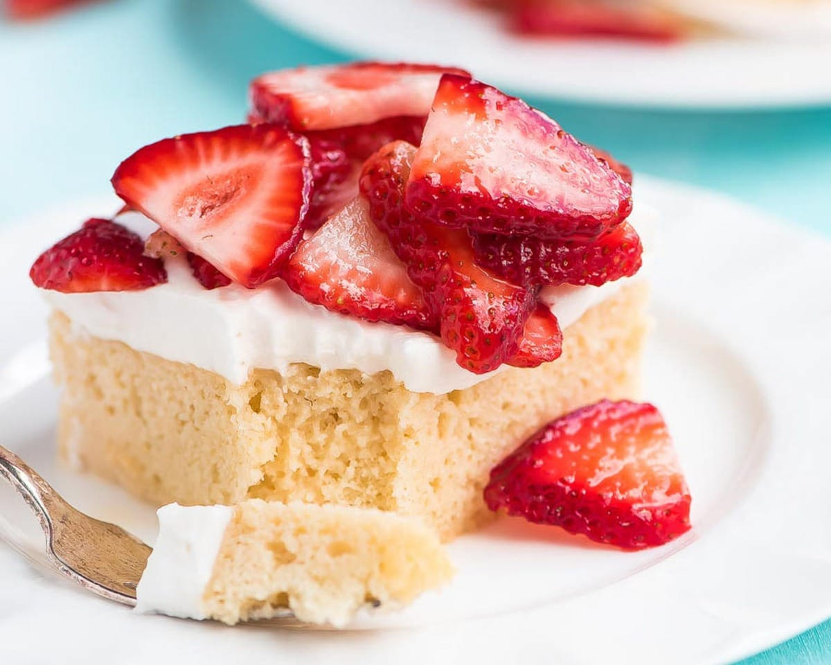 Tres Leches Recipe with strawberries on top