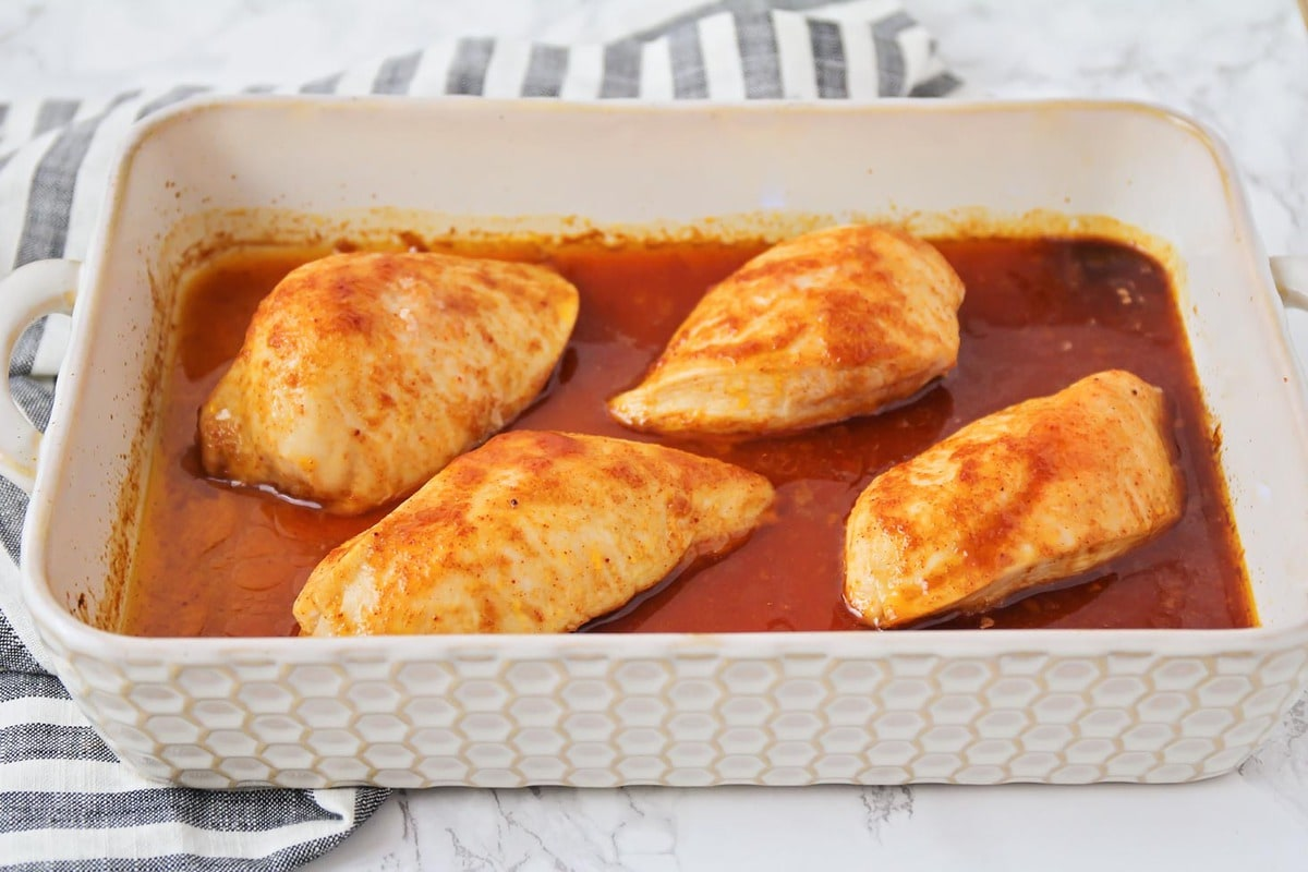 Baked bbq chicken breasts in a baking pan