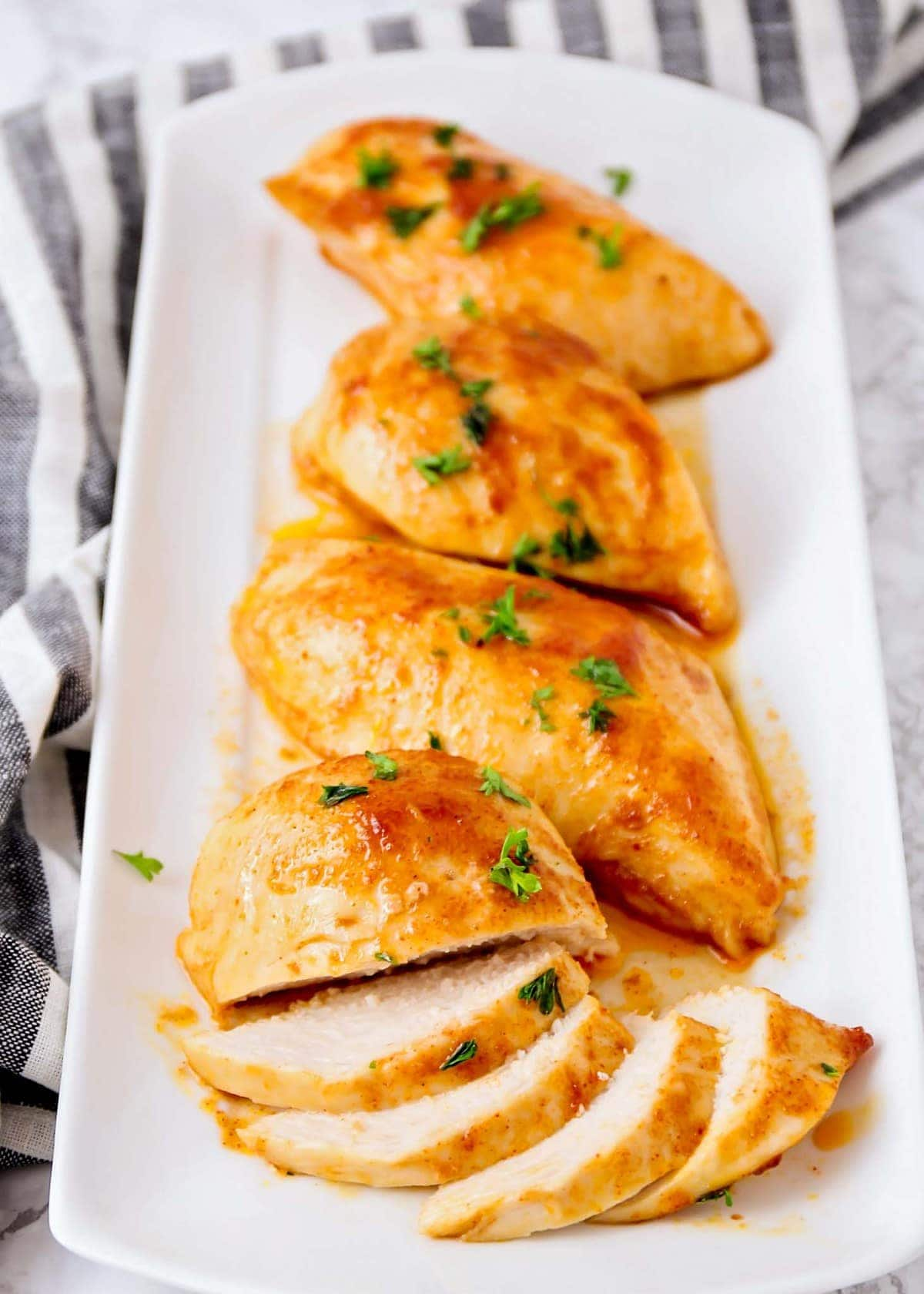 Oven baked bbq chicken breasts on a platter