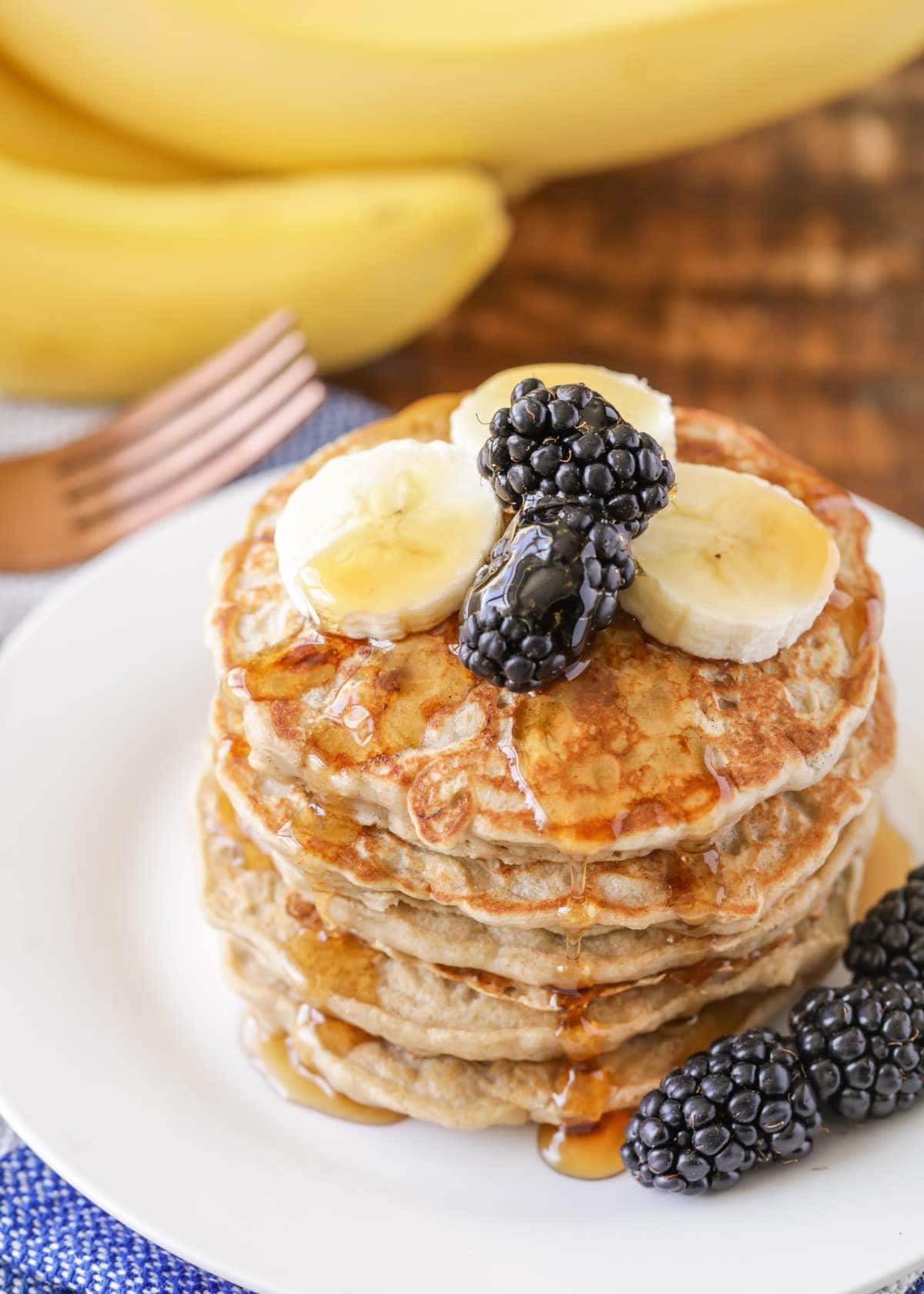 Banana oatmeal pancake recipe with berries and syrup on top