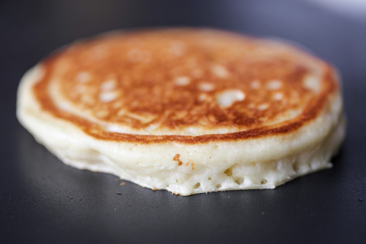 Close up of fluffy pancake recipe on griddle