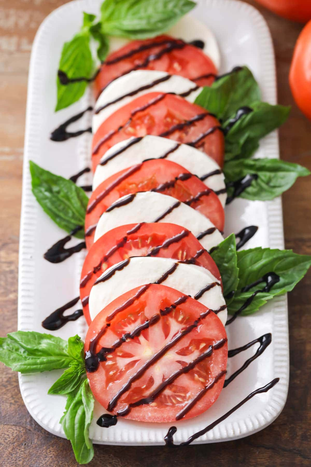 Tomato basil mozzarella salad with balsamic glaze drizzle
