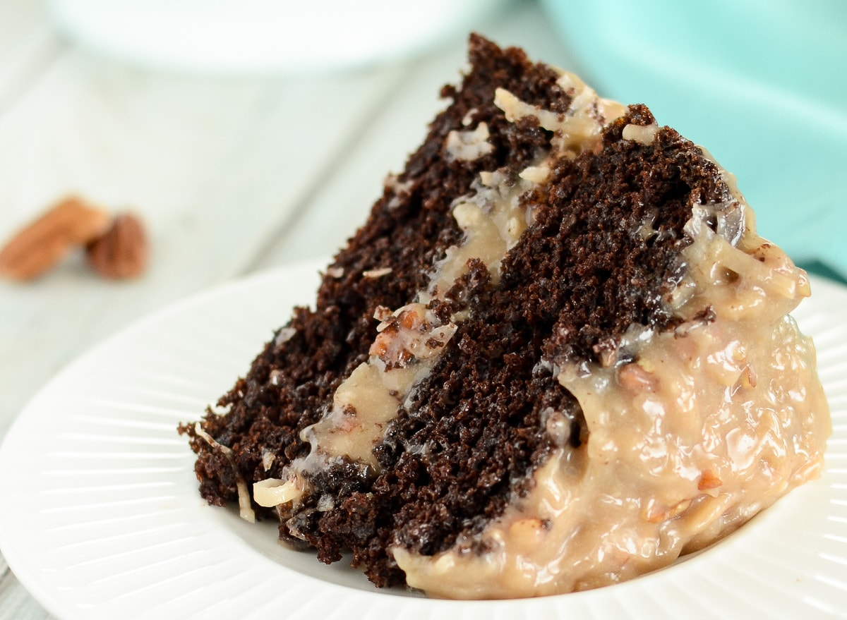 Slice of German Chocolate Cake with coconut pecan frosting