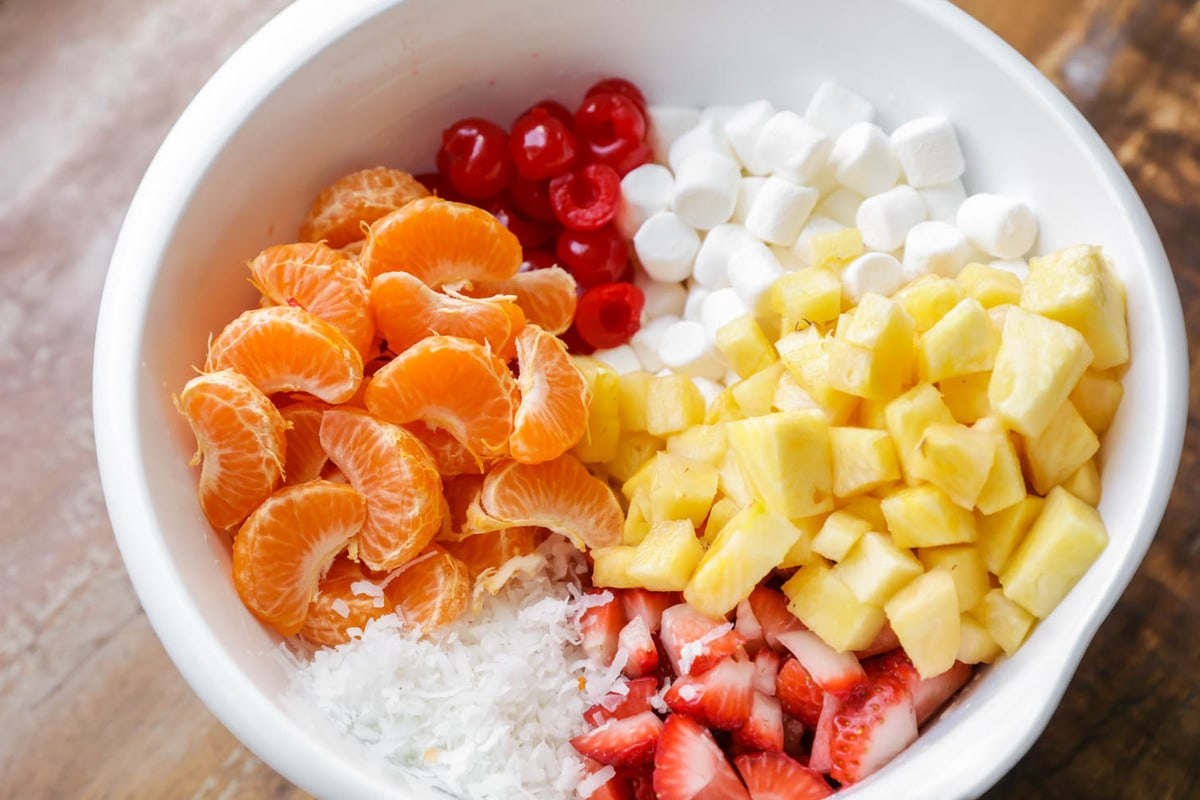 ambrosia salad ingredients in a bowl before mixing