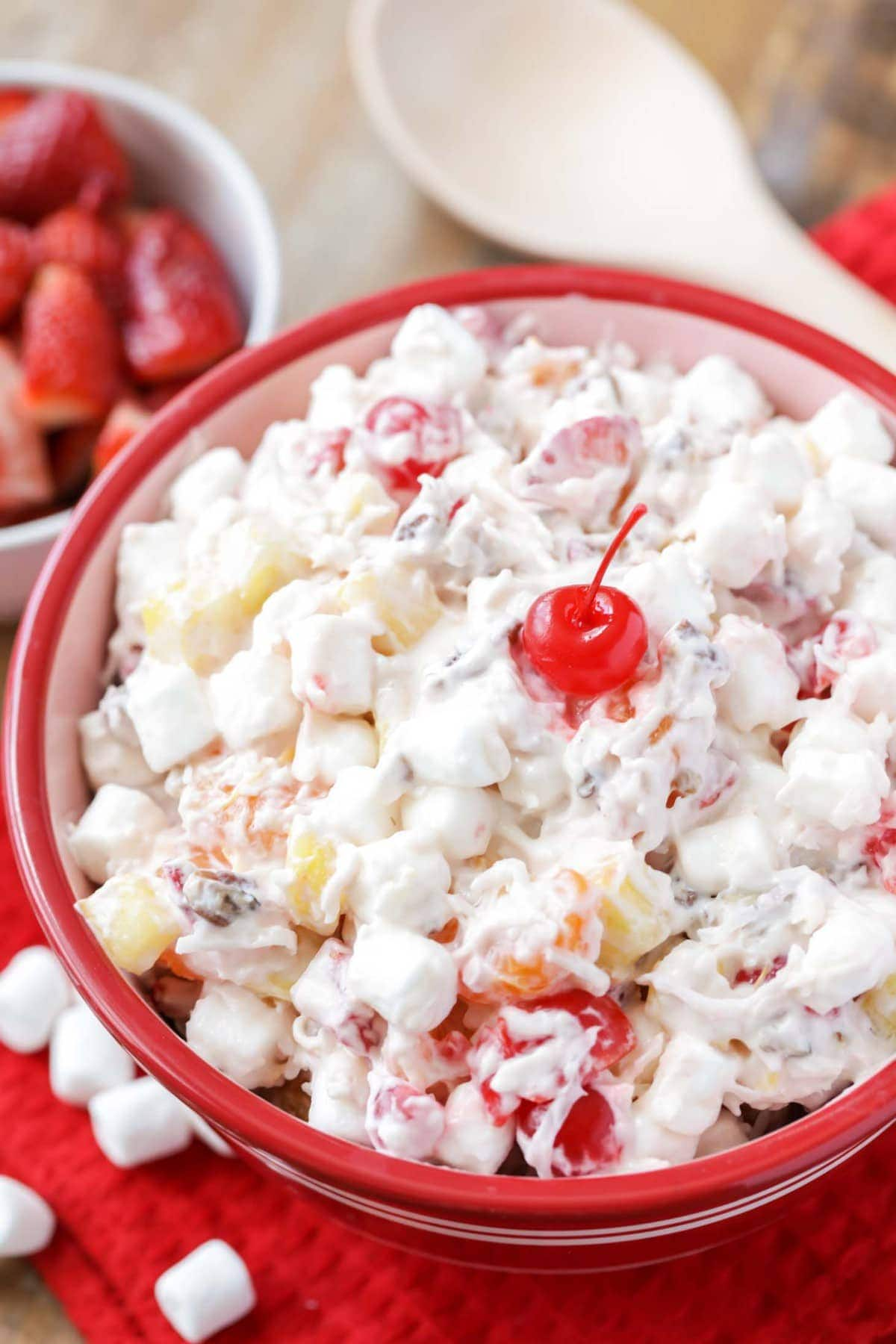 closeup of ambrosia salad in a red bowl