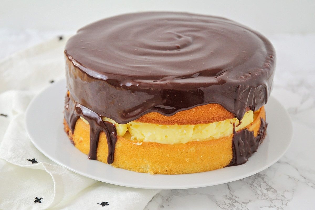 Boston Cream Pie Cake topped with ganache