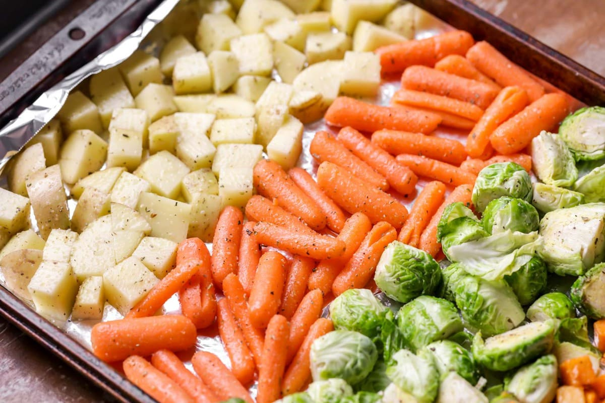 Close up of seasoned vegetables on a sheet pan