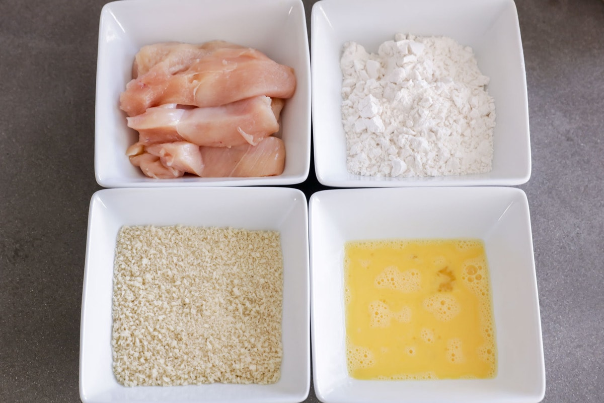 Bowls of flour, panko, and egg for battering chicken tenders