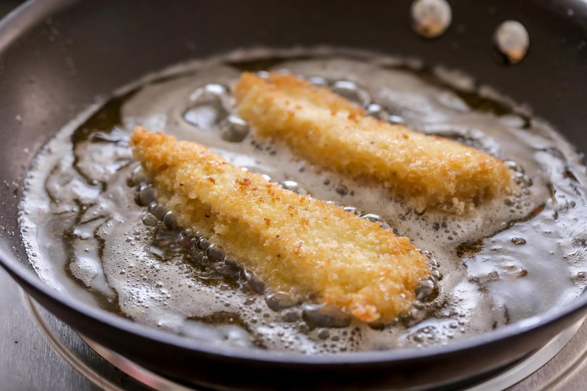 Deep fried chicken tenders in a frying pan