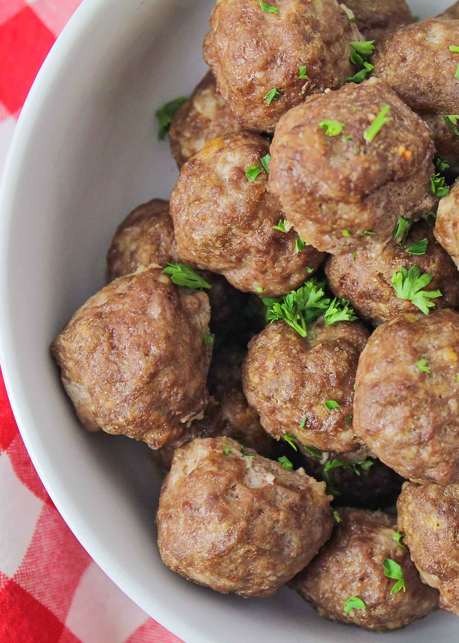 Homemade meatballs in white bowl