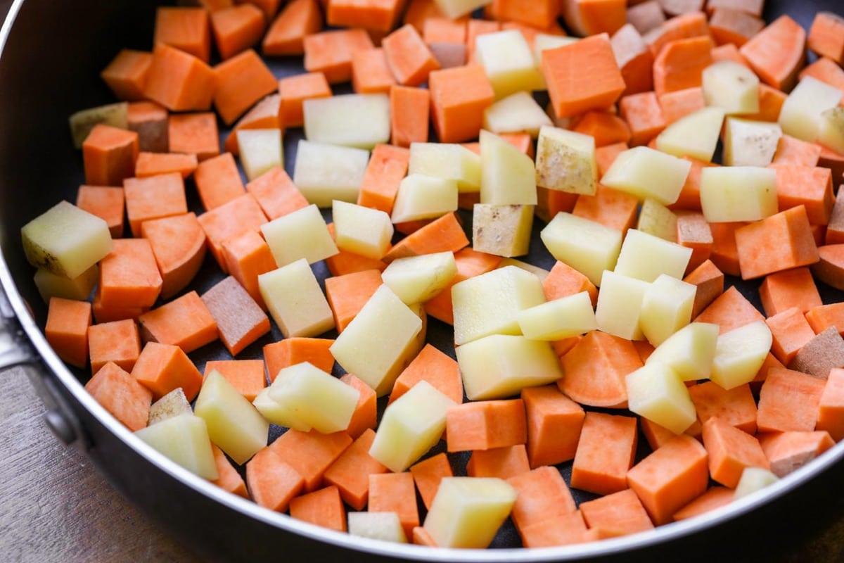 ingredients for sweet potato breakfast hash in a skillet