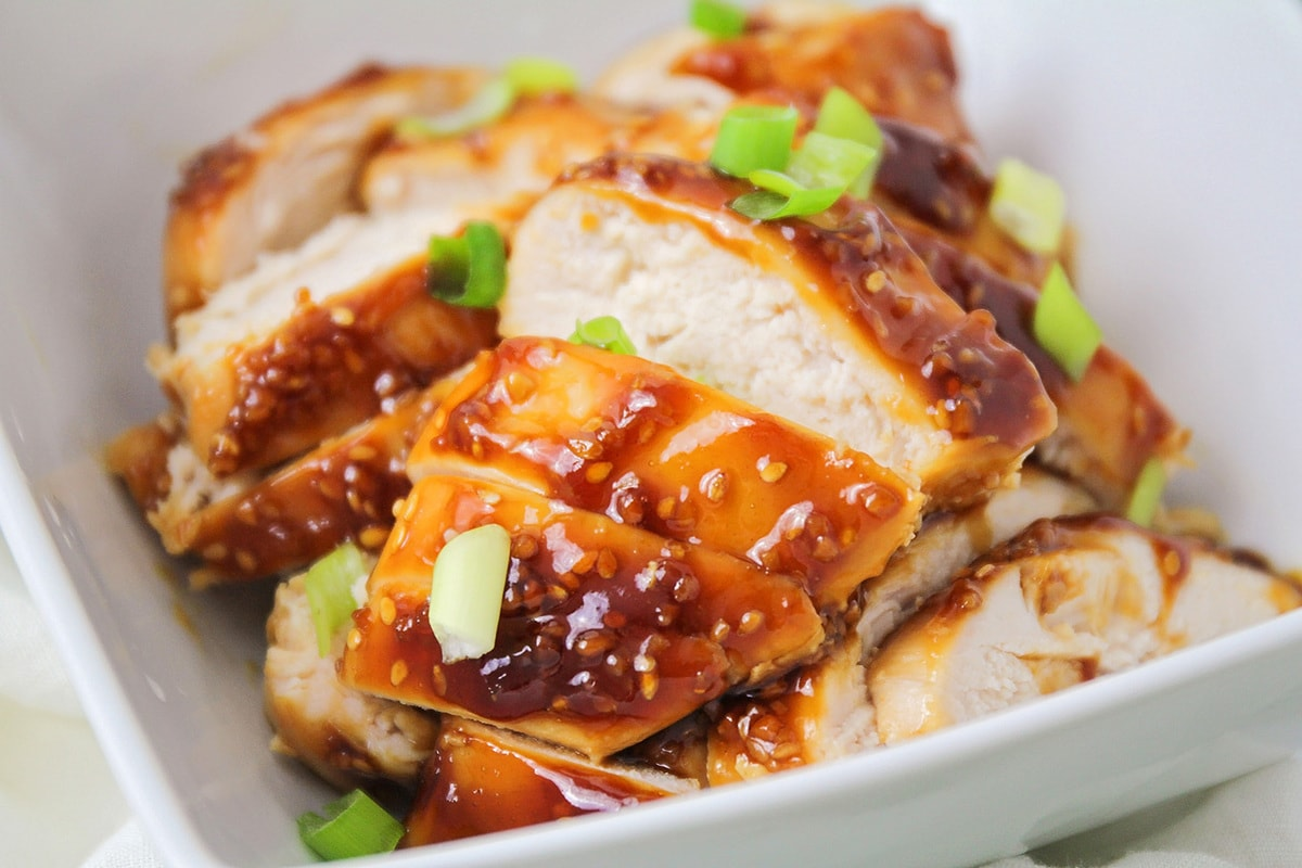 Sliced baked teriyaki chicken breast in a bowl