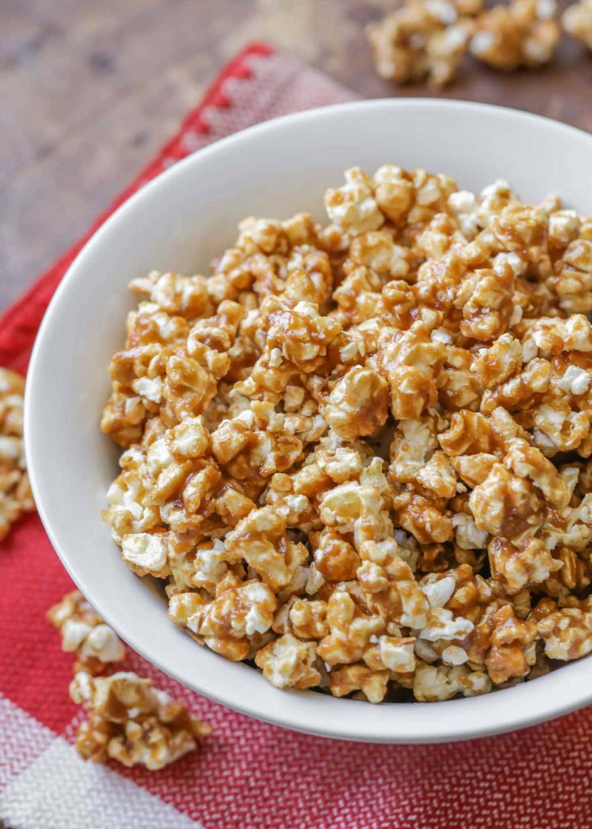 Homemade caramel corn in a white bowl