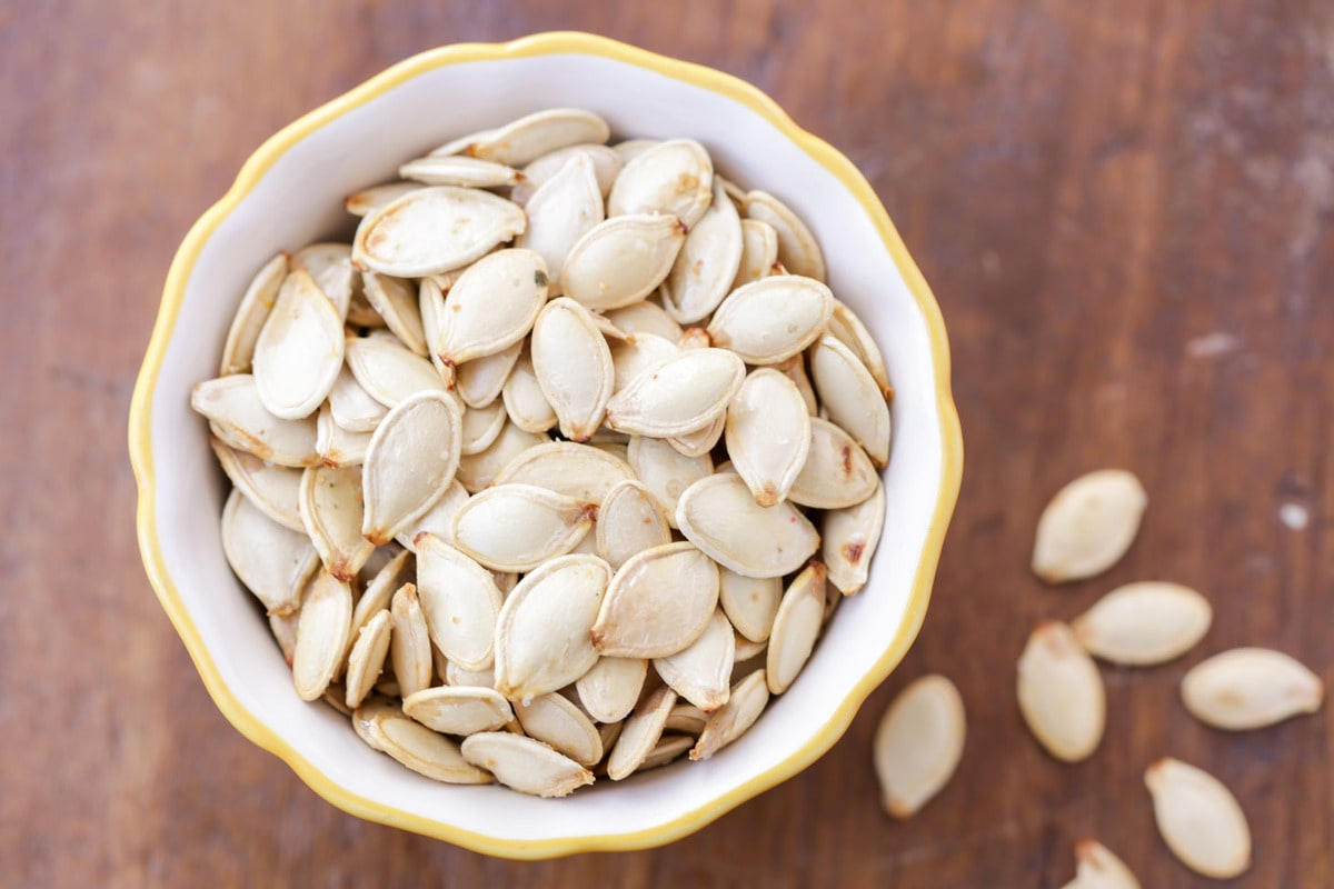 Roasted pumpkin seeds in a small dish