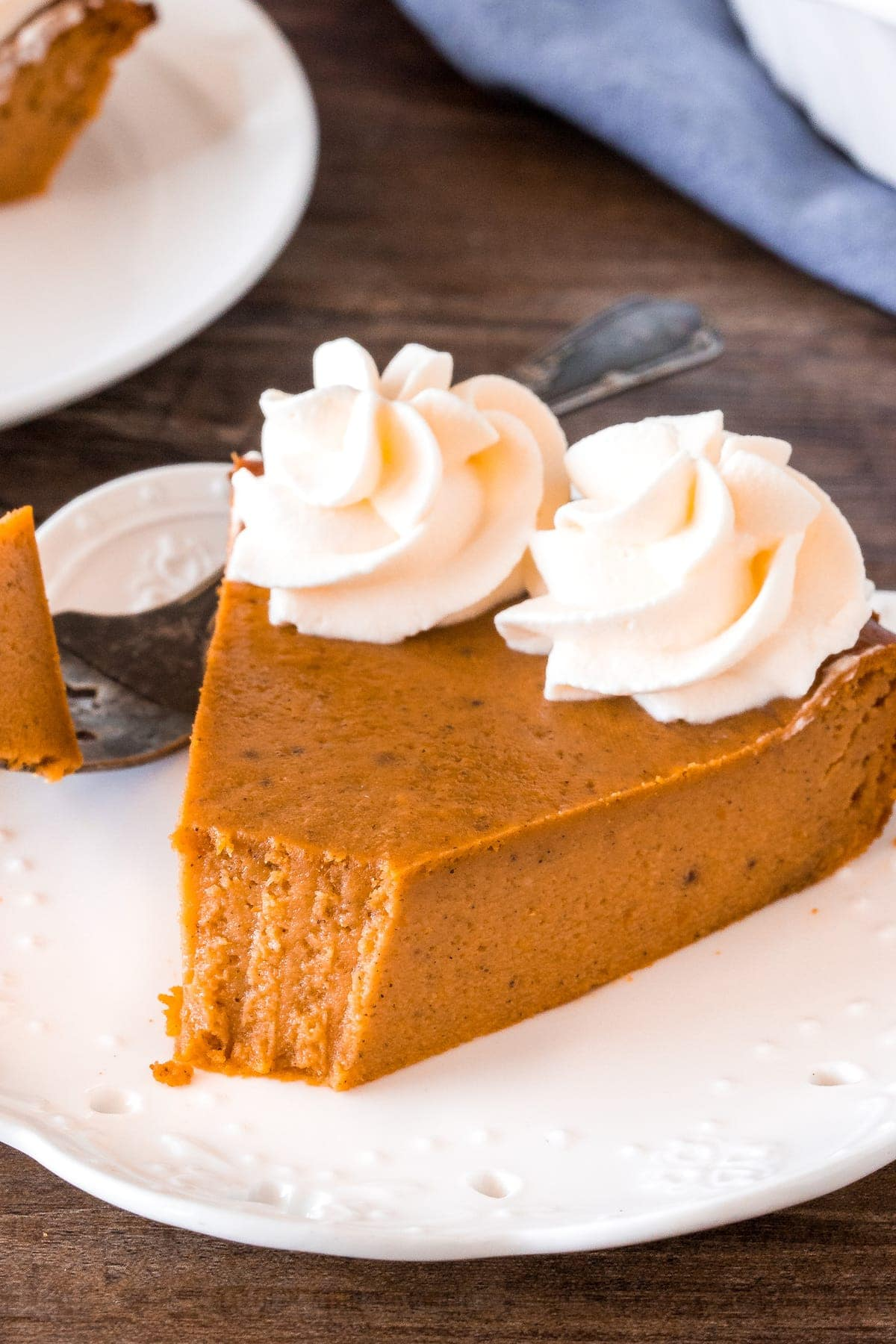 A slice of pumpkin pie without the crust.