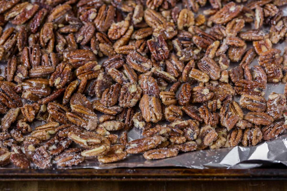 close up of easy candied pecans on a cookie sheet