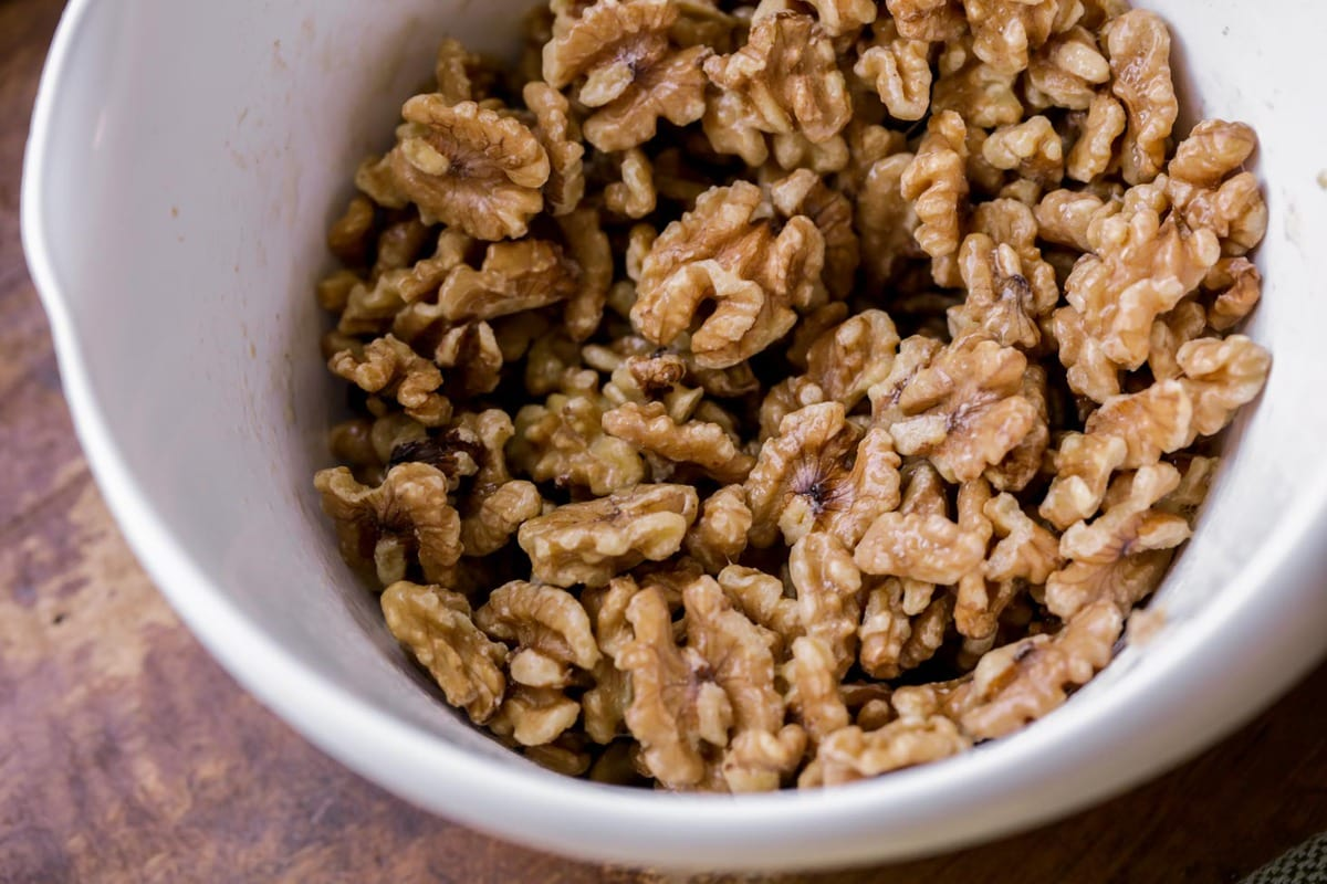 Raw walnuts in a bowl to make candied walnuts