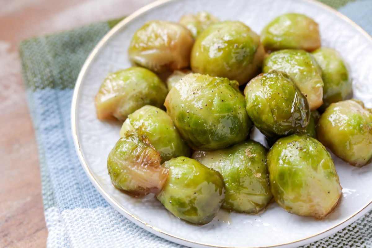 Caramelized brussel sprouts on a white plate