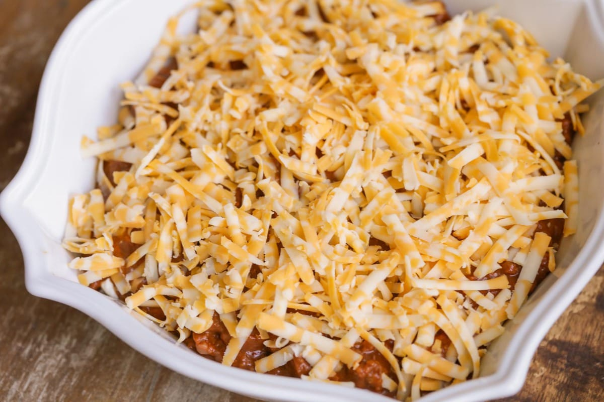 Shredded cheese on top of hormel chili dip