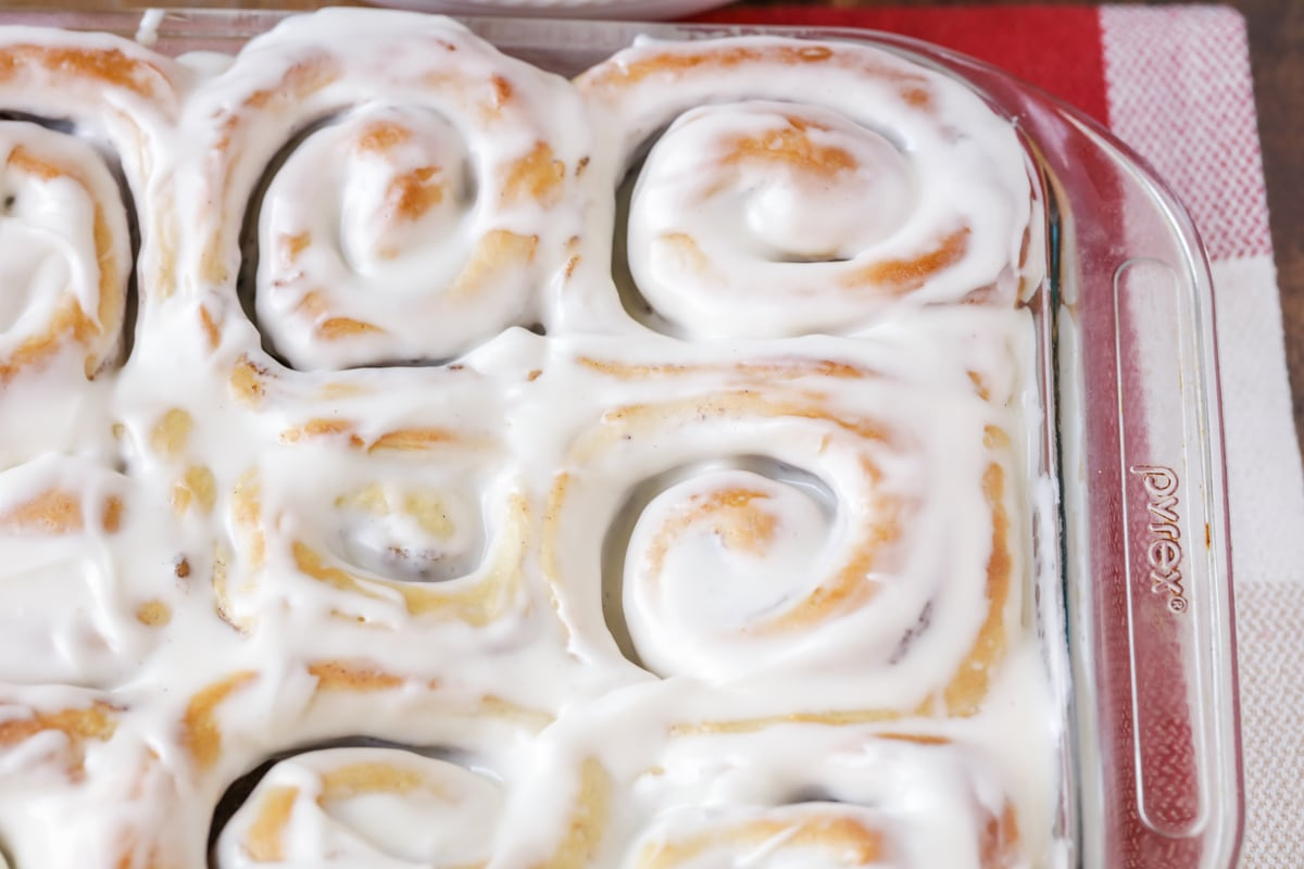 cinnamon roll icing on top of cinnamon rolls