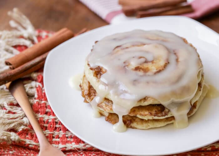 Cinnamon roll pancakes on a white plate