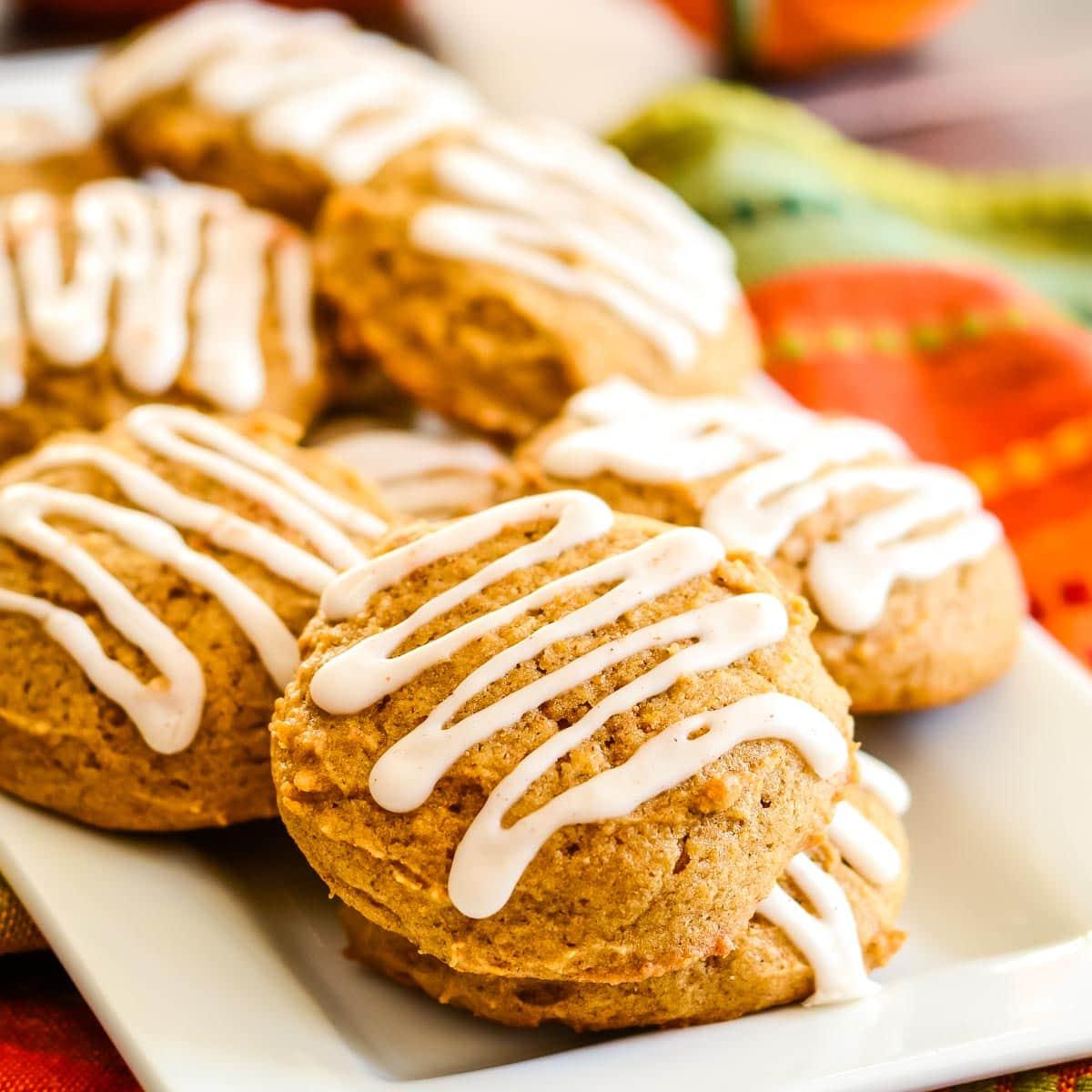 Iced pumpkin cookies on plate