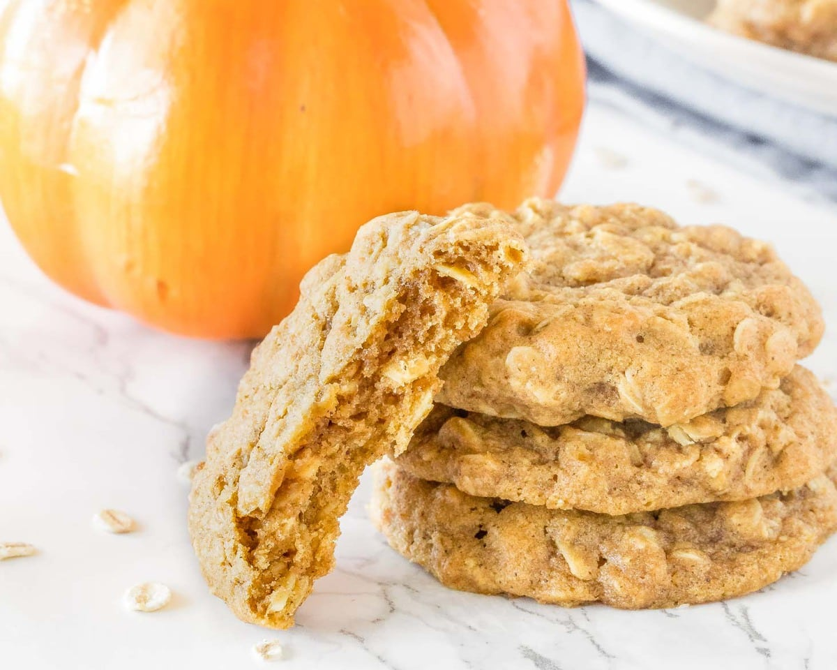 Pumpkin oatmeal cookies stacked on counter