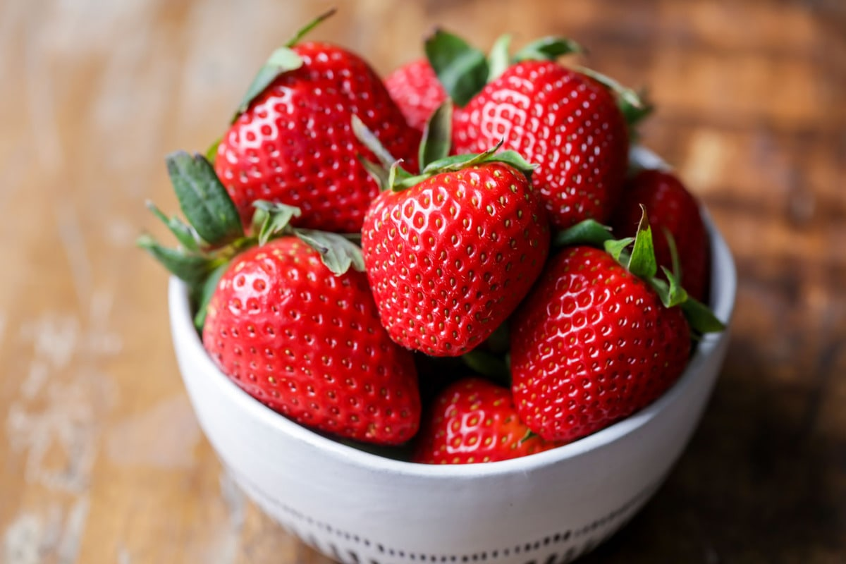 Strawberries in a bowl for strawberry vinaigrette recipe
