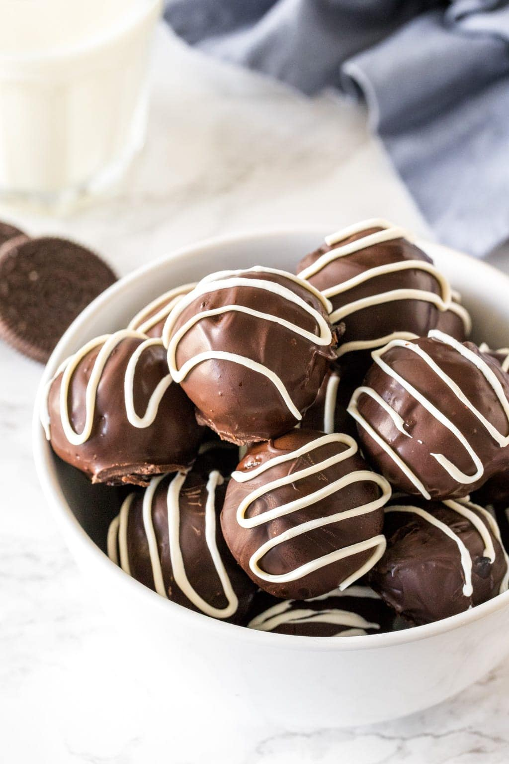 A bowl of Oreo truffles coated in chocolate.