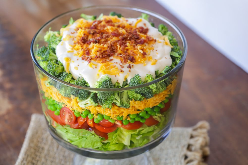 7 Layers of Goodness in this delicious layered Salad. This recipe isn't only delicious, but is easy to customize and is great to make ahead of time too!