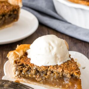 A slice of brown sugar oatmeal pie with a scoop of vanilla ice cream on top.